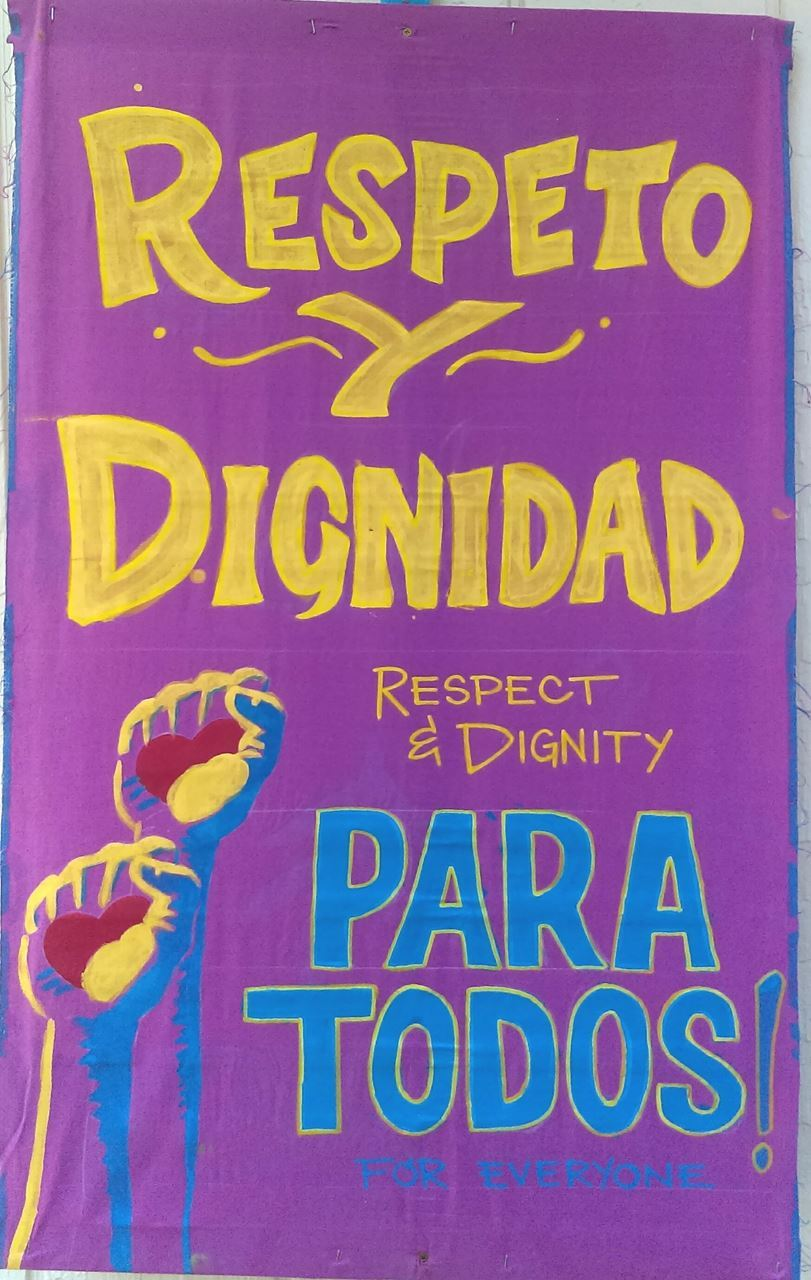 Spanish Language Immigrant Rights sign created with local immigrant community